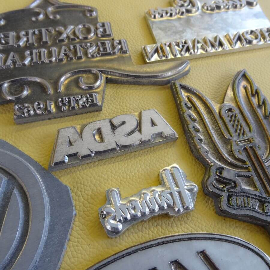 Metal logo dies used for embossing